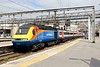 23 April 2015 :: Hired in by VTEC, East Midlands HST with power car 43045 is seen departing from Kings Cross working 1D11, the 1105 to Leeds