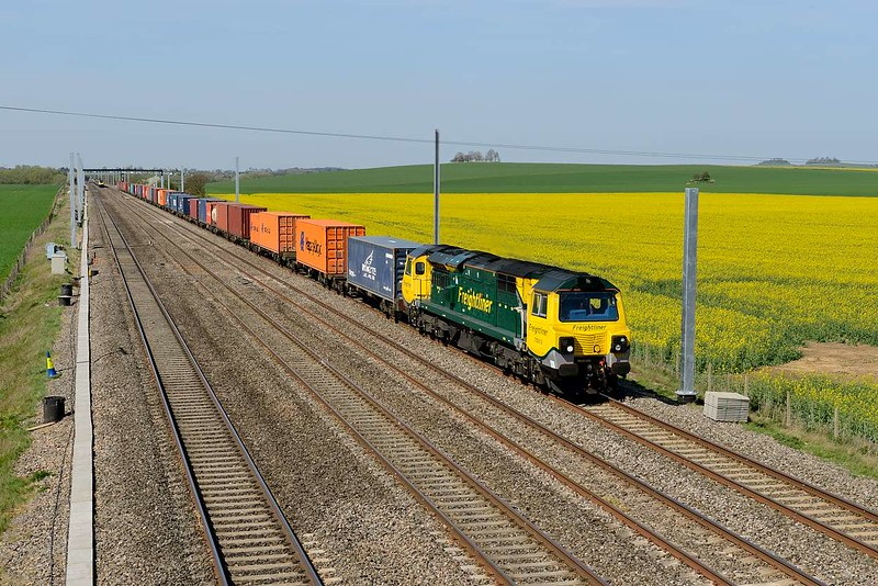 15 April 2015 :: With the oil seed rape coming into flower at Cholsey we see 4O27 from Garston to Southampton passing powered by 70013