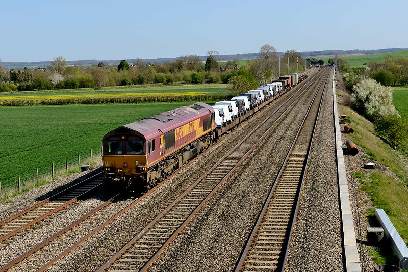 15 April 2015 :: 6X38 from Eastleigh to Didcot is transporting some vans today and is seen at Cholsey with 66135