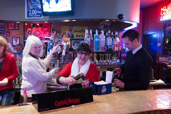 JOED VIERA/STAFF PHOTOGRAPHER- Lockport, NY-Nancy Post Lange, Maria Biano and Brian Smith practice tending bar at the the Davison Road Inn.