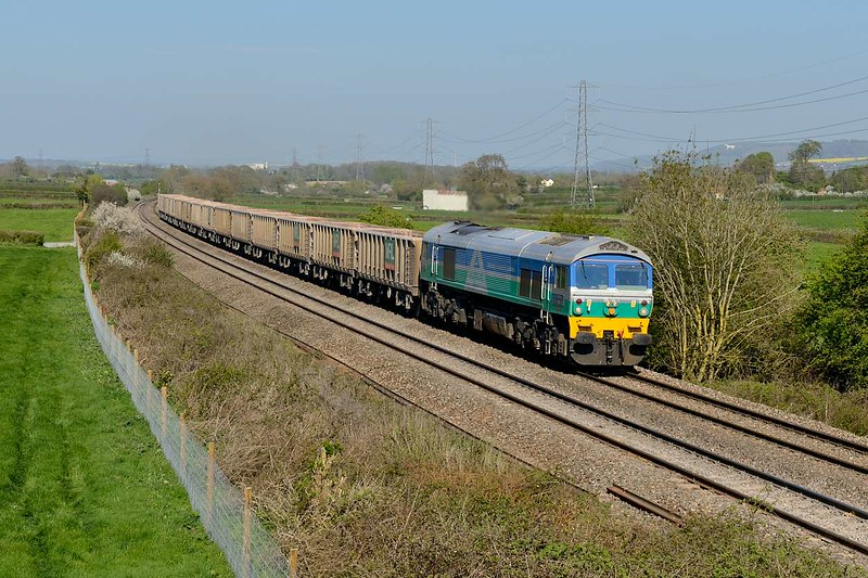 21 April 2015 :: With the Westbury White Horse in  the distance 59001 is seen at Berkley working 6V07 from Chichester to Merehead