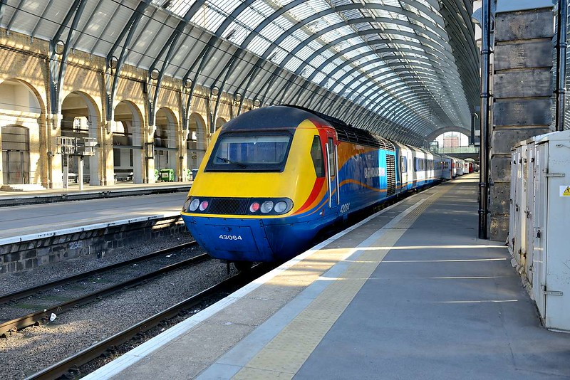 18 April 2015 :: Inside Kings Cross station is East Midlands HST set with 43064 nearest the camera.  It had had been hired in by Virgin Trains East Coast and is waiting to work empty to Bounds Green Depot