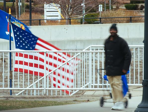 JOED VIERA/STAFF PHOTOGRAPHER- Lockport, NY-A man walks past a windy   Flight of Five.
