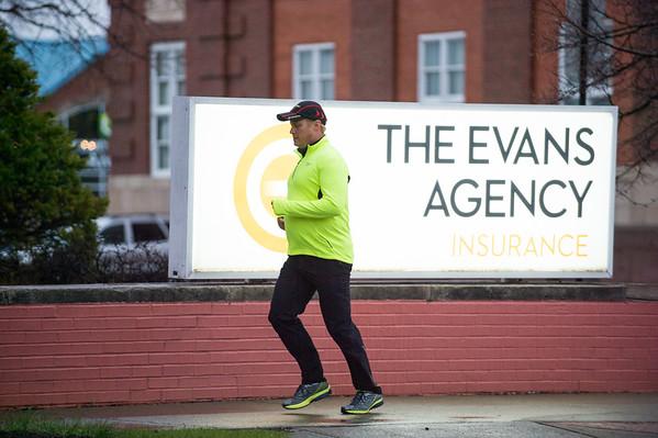 JOED VIERA/STAFF PHOTOGRAPHER-Lockport, NY-Kevin Mietlicki goes for a run on Main Street.