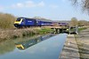 8 April 2015 :: In glorious spring sunshine and still conditions which produced a wonderful reflection in the Kennet & Avon Canal, 43155 'The Red Arrows' passes near Little Bedwyn working 1C79, the 1106 Paddington to Plymouth