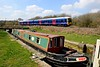 8 April 2015 :: As a barge passes through a lock on the Kennet & Avon Canal near Little Bedwyn, 165135 passes by with 1K61, the 1238 Bedwyn to Reading