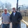 JOED VIERA/STAFF PHOTOGRAPHER-Burt, NY-Brian Scott and Norb Bochenski take a break from tending to the Burt Dam Power Station.