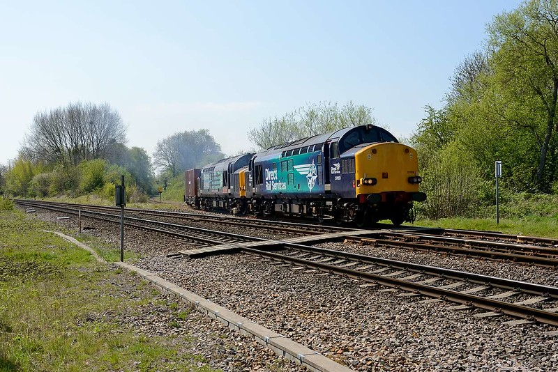 20 April 2015 :: Having now been given the road, 37059/610 and 1 wagon join the main line at Berkeley Road Junction with 6M56