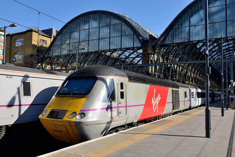 18 April 2015 :: HST power car 43296 adorned with a Virgin logo stands at Kings Cross waiting to work 1S26, the 1700 to Edinburgh