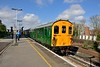 18 April 2015 :: The Green Dragon railtour from Hastings to Cardiff Central (1Z08) utilising The Hastings Unit DEMU 1001 is pictured arriving into Woking