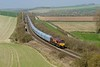 9 April 2015 :: Another train diverted due to the major engineering work in the Reading area was 4O40 the minis from Cowley to Southampton.  The train is pictured among the rolling hills near Great Wishford led by 66140