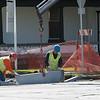 JOED VIERA/STAFF PHOTOGRAPHER-Lockport, NY-Crews work on the sidewalk on Hawley Street and Niagara Street.