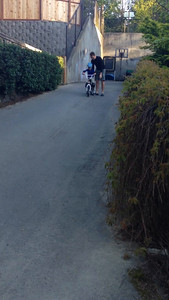 Connor's first trip down the driveway on a bike!