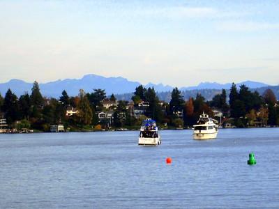 Two Tailgating Boats Drift Toward the University of Washington on our Argosy Lakes Cruise