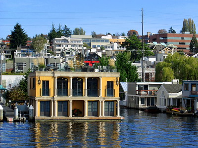 Yellow Floating Home With Columns in Seattle's Lake Union, Seen on the Argosy Lakes Tour