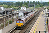 15 August 2015 :: 0X12 pauses briefly on the main line at Didcot Parkway Station and we see 66145+66132+66152+66085+66035 and 66124 at the rear