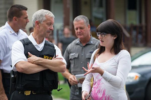JOED VIERA/STAFF PHOTOGRAPHER-Lockport, NY-Lockport Police Chief Larry Eggert speaks to the suspects girlfriend on Washburn Street.