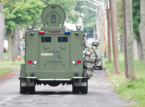 JOED VIERA/STAFF PHOTOGRAPHER-Lockport, NY-The Niagara County Sheriff's Emergency Response Team drives down Spalding Street.