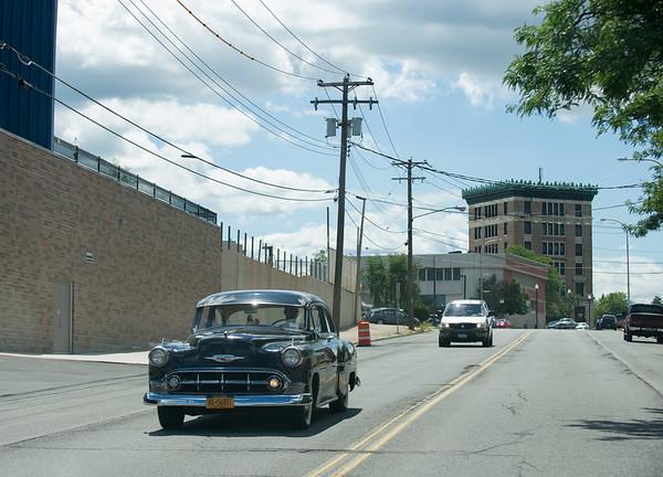 JOED VIERA/STAFF PHOTOGRAPHER-Lockport, NY-A classic car drives down Market Street.