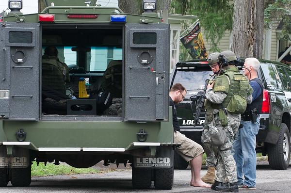 JOED VIERA/STAFF PHOTOGRAPHER-Lockport, NY-Niagara County Sheriff Deputies and Lockport Police Officers speak to a suspect on Spalding Street