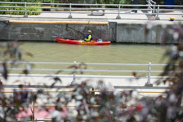 JOED VIERA/STAFF PHOTOGRAPHER-Lockport, NY-A kayaker waits for the locks to open.