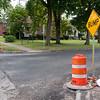 JOED VIERA/STAFF PHOTOGRAPHER-Lockport, NY-A sign warns motorist of a bump on High Street and Pine Street.