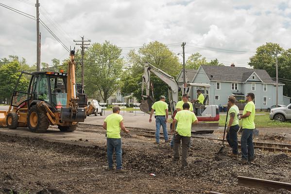 JOED VIERA/STAFF PHOTOGRAPHER-Lockport, NY-Falls Road Railroad Company crew works on the track at Niagara Street.