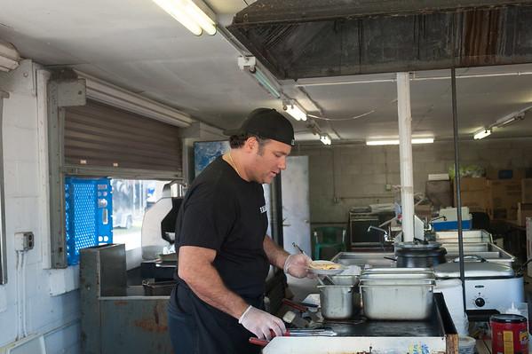 JOED VIERA/STAFF PHOTOGRAPHER-Lockport, NY-Michael Mollinaro makes some food at the fair.