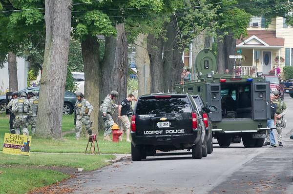 JOED VIERA/STAFF PHOTOGRAPHER-Lockport, NY-Niagara County Sheriff Deputies and Lockport Police Officers apprehend a suspect on Spalding Street