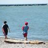 JOED VIERA/STAFF PHOTOGRAPHER-Olcott, NY-Ryder 8 and River Jones 6 skip stones across Lake Ontarion at Olcott Beach.