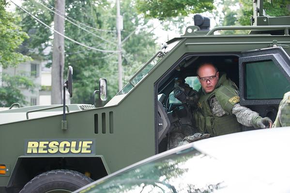 JOED VIERA/STAFF PHOTOGRAPHER-Lockport, NY-A Niagara County Sheriff's deputy closes the door of a Emergency vehicle.