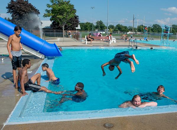 JOED VIERA/STAFF PHOTOGRAPHER-Lockport, NY- Swimmers enjoya a dip at the Lockport Public Pool.