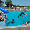 JOED VIERA/STAFF PHOTOGRAPHER-Lockport, NY- Swimmers enjoya a dip at the Lockport Public Pool.