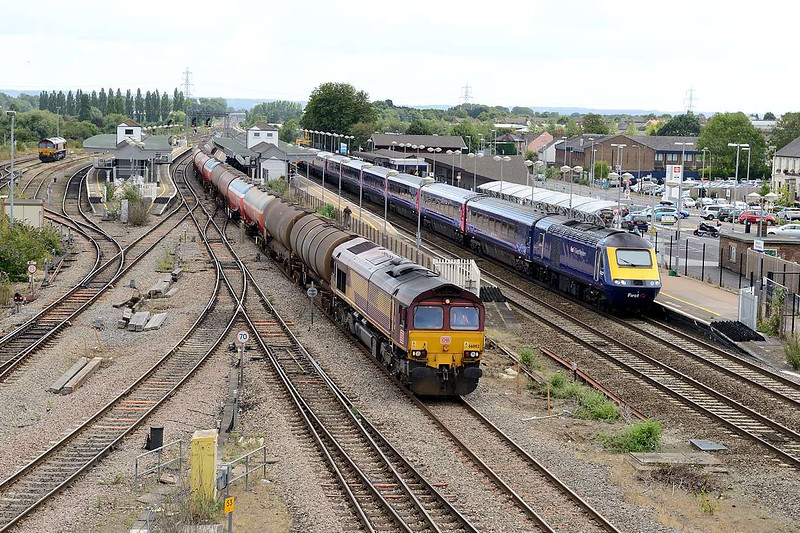 15 August 2015 :: Unusually for 6B33 from Theale to Margam did not have a Class 60 allocated to the working.  Passing Didcot we see 66002 was through the station with the empty oil tanks