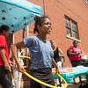 JOED VIERA/STAFF PHOTOGRAPHER-Lockport, NY-Kavaya Rhim 10 hula hoops during the Community Health Center of Buffalo's Open House on Heritage Place.