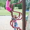 JOED VIERA/STAFF PHOTOGRAPHER-Lockport, NY-Keiasia Hill (4) and Kasia Robinson 5 climb the jungle gym at Day Road Park.