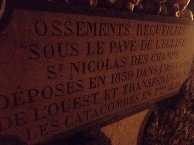 Sign in the Catacombs of Paris, Detailing the Original Burial Grounds of These Specific Bones