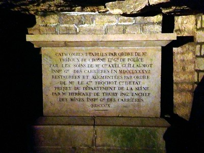 Informational Sign in the Dark Catacombs of Paris, France