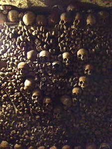 Skulls Form a Heart Amongst Bones in the Creepy Catacombs of Paris, France