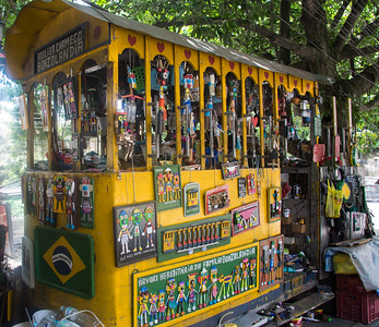 An artist exhibit on the street using recycled materials.