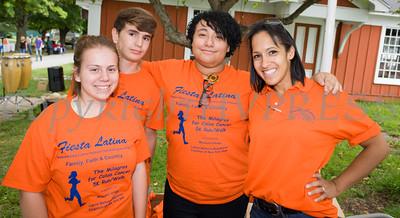 A group of volunteers greet those attending Fiesta Latina at Museum Village in Monroe, NY on Saturday, September 12, 2015. Hudson Press/CHUCK STEWART, JR.