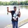 Olivia Elmore caught a Blue Gill Sunfish during TEAM Newburgh's seventh annual fishing trip to Lake Washington on Thursday, July 23, 2015. Hudson Valley Press/CHUCK STEWART, JR.