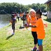 Brianna LaBarbera assists Aaliyah during TEAM Newburgh's seventh annual fishing trip to Lake Washington on Thursday, July 23, 2015. Hudson Valley Press/CHUCK STEWART, JR.