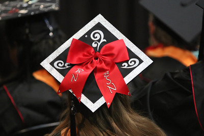 Cap decorations sometimes represent the field of study the student is graduating from. Photo by Megan Hartman