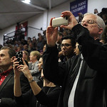 Family and friends use their cell phones to take photos of the graduating members as they arrive. Photo by Elizabeth Banfield