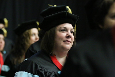 Doctoral candidates walk to their seats. Photo by Megan Hartman