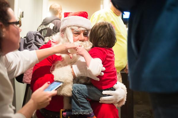 JOED VIERA/STAFF PHOTOGRAPHER Lockport, NY-Santa gives Anna Belle Maskell a hug.