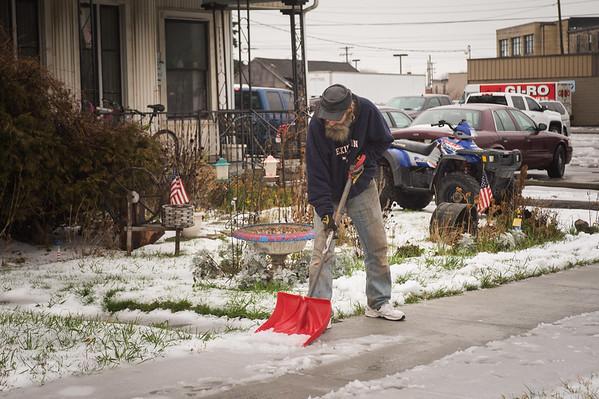 JOED VIERA/STAFF PHOTOGRAPHER Lockport, NY-Carl Stover shovels his slushy sidewalk.