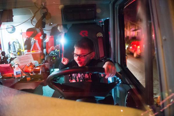 JOED VIERA/STAFF PHOTOGRAPHER Lockport, NY-Justin Mistalski plays in a fire engine.