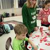 JOED VIERA/STAFF PHOTOGRAPHER Pendleton, NY-Gabriella Molak helps Richard Finiki 5 make Christmas crafts at Starpoint's Winterfest.